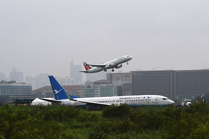 International, local airlines fined for uncoordinated �Xiamen� flights