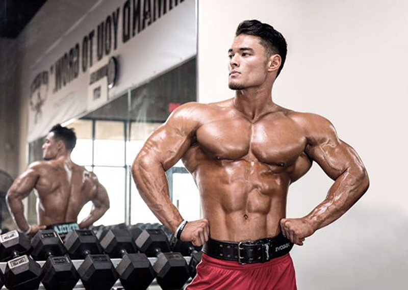 fil am olympia champ jeremy buendia sets the bar high for men s