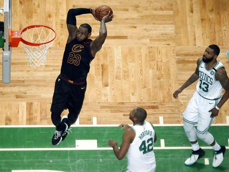 1fbbe6f84d6 ... forward LeBron James soars to dunk in front of Boston Celtics forward  Al Horford (42) and forward Marcus Morris (13) during the first half in Game  7 of ...