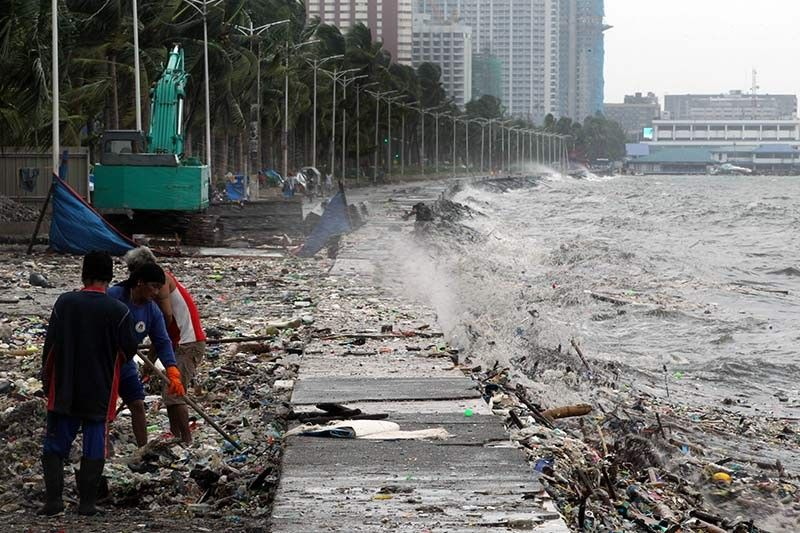 IN PHOTOS: Monsoon downpour messes with wedding, floods streets, spawns sea of garbage