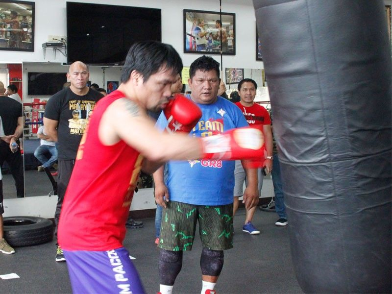 'Inspired' Pacquiao opens training camp