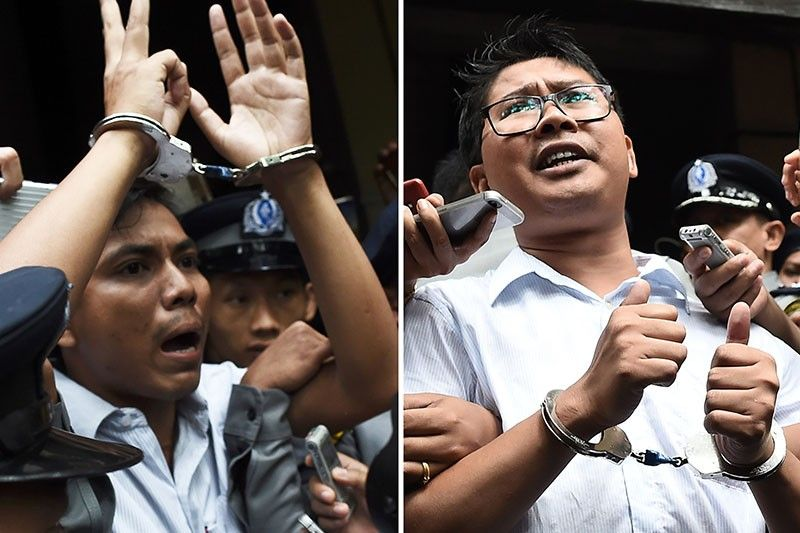 This combo shows journalists Kyaw Soe Oo (L) and Wa Lone (R) being escorted by police after their sentencing by a court to jail in Yangon on Sept. 3, 2018. Two Reuters journalists were jailed on September 3 for seven years for breaching Myanmar's official secrets act during their reporting of the Rohingya crisis, a judge said, a case that has drawn outrage as an attack on media freedom.