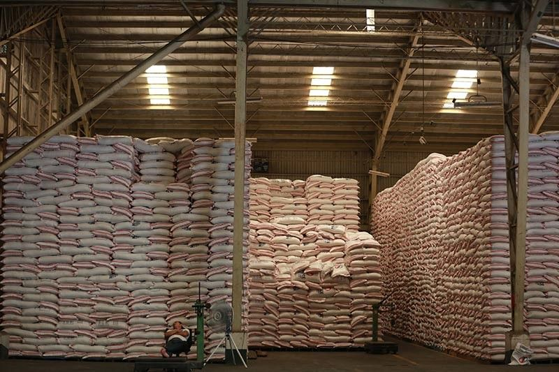 A worker resting at the NFA warehouse in Quezon City on Oct. 8, 2018. Philippine laws are silent on how rice shipments will be charged, precisely the reason that President Duterte's own economic managers are pushing for the rice tariffication bill's passage.