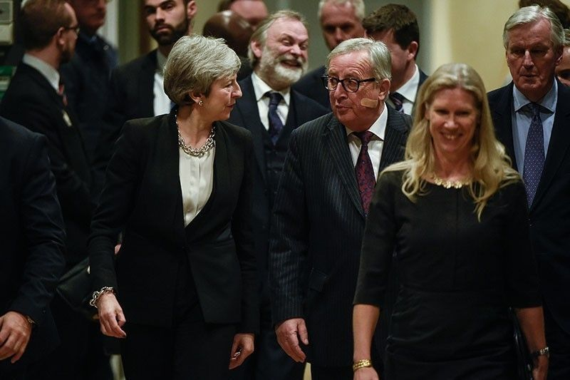 European Commission President Jean-Claude Juncker (C-R) welcomes British Prime Minister Theresa May (C-L) as she arrives at the EU headquarters in Brussels to hold a meeting on Brexit talks on February 20, 2019. AFP/John Thys