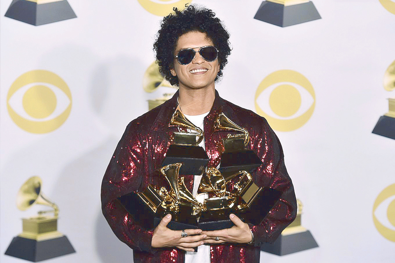 3e2a6be64ffce Bruno Mars with his trophies for Best R B Album