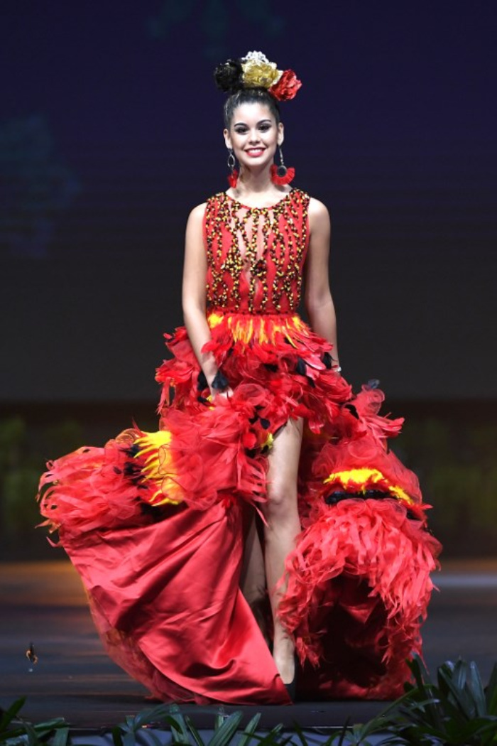 e2cfcceec7bf Belgium: this designer dress is made out of tissues and feathers that form  the three Belgian colors – yellow, red and black, ornamented by two pounds  of ...