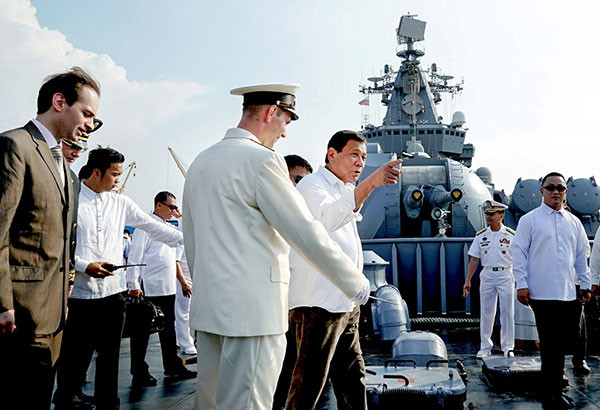 """In this April 21 photo, President Rodrigo Duterte is given a tour of the Russian guided missile cruiser """"Varyag"""" that arrived in Manila yesterday for a four-day goodwill visit.File"""