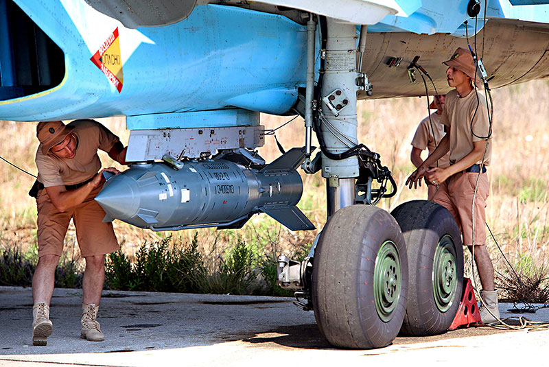 Soldiers prepare a Russian-made KAB-500S precision-guided munition in an image posted on Russia Today. The satellite-guided KAB-500S bombs have been used in Russian strikes against the Islamic State in Syria.