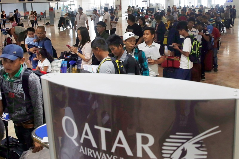 Government on alert for OFW repatriation from Qatar | Philstar com