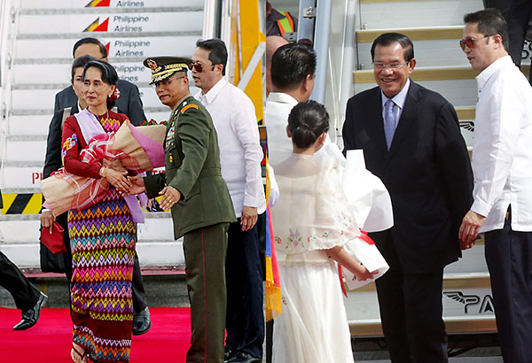 State Counsellor Aung San Suu Kyi of Myanmar (left) and Cambodian Prime Minister Hun Sen arrive at the Clark International Airport in Pampanga yesterday for the 31st ASEAN Summit.Geremy Pintolo, Ernie Peñaredondo