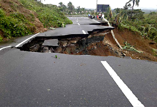 Photo contributed by Efren Iquiran Garabiles shows a highway in Pinabacdao, Samar which collapsed due to heavy rains brought by Storm Urduja.
