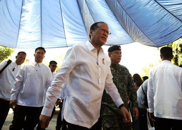 In this March 4, 2015 file photo, then President Benigno Aquino III arrives to attend the Assumption of Command Ceremony of the Philippine National Police Special Action Force (SAF) at Camp Bagong Diwa, Taguig, Philippines, on Wednesday March 4, 2015. AP/Aaron Favila
