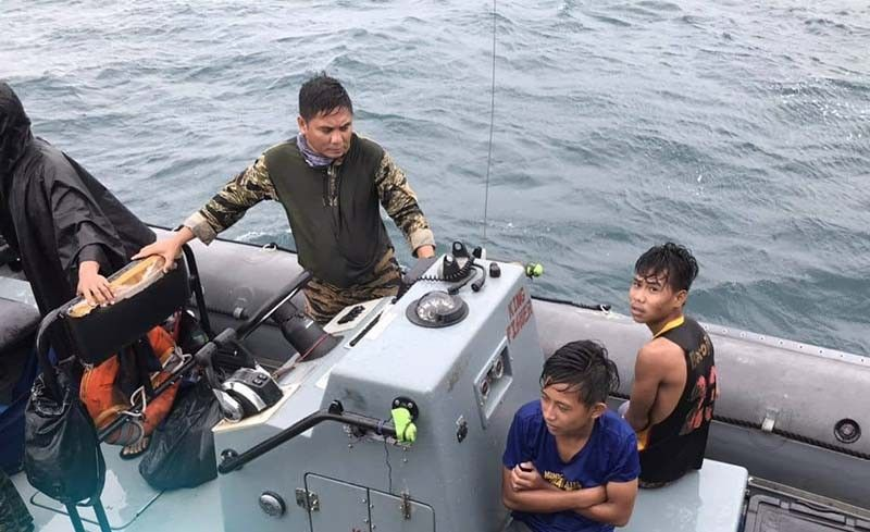 Navy ship rescues 2 teens from capsized banca off Balangiga