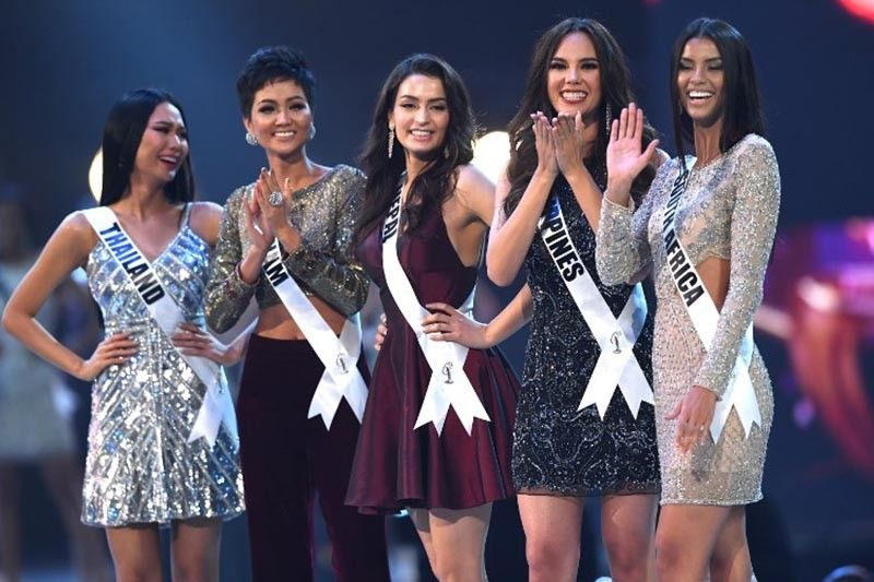 Miss Universe contestants (L-R) Sophida Kanchanarin of Thailand, H'Hen Nie of Vietnam, Manita Devkota of Nepal, Catriona Gray of Philippines and Tamaryn Green of South Africa stand together after selected as top 20 candidates during the 2018 Miss Universe Pageant in Bangkok on December 17, 2018.