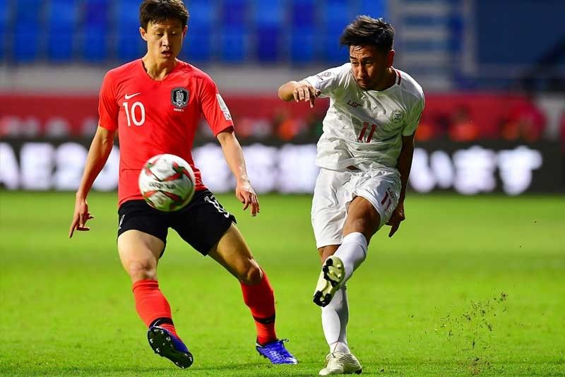 Daisuke Sato (right) fights for the ball during the 2019 AFC Asian Cup football game between Korea and Philippines at the al-Maktoum stadium in Dubai.