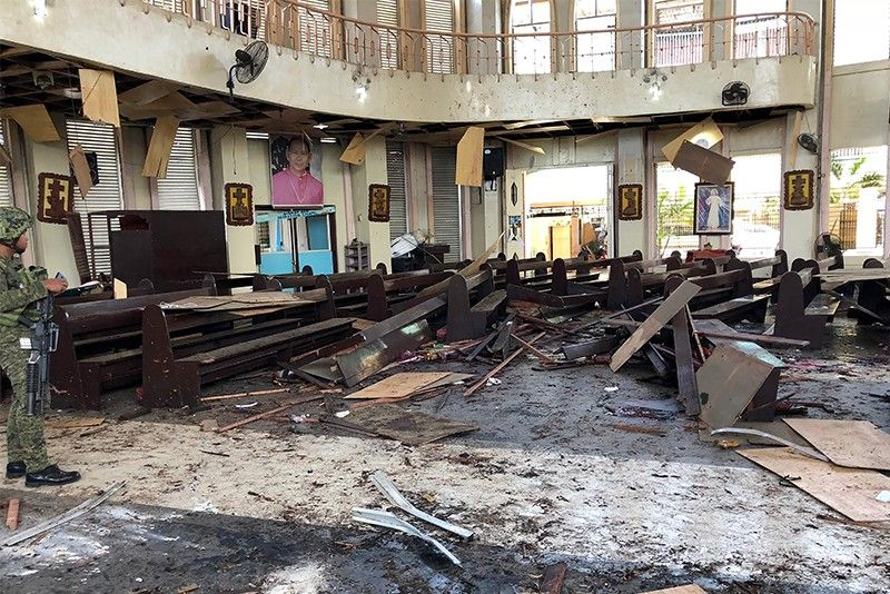 This handout photo released by Armed Forces of the Philippines (AFP) Public Information Office (PIO) Western Mindanao Command (WESTMINCON) taken on January 27, 2019, shows debris inside a Catholic Church where two bombs exploded in Jolo, Sulu province on the southern island of Mindanao. At least 17 people were killed as two bombs hit a church on a southern Philippine island that is a stronghold of Islamist militants, the military said, just days after a regional vote for a new Muslim autonomous region. The first blast occurred inside the Catholic church on war-torn Jolo on Sunday morning as mass was being celebrated, and was followed by a second explosion in the parking lot as troops responded, regional military spokesman Lieutenant Colonel Gerry Besana told AFP.