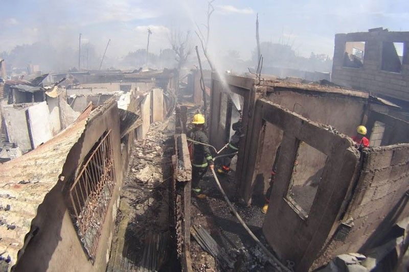 4 hurt, over 100 houses razed by separate fires | The Freeman
