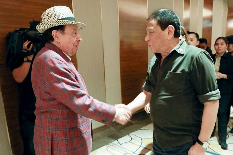 President Duterte and Sergio Mendes exchange pleasantries after the Brazilian musician�s Valentine�s Day concert at the Solaire Resort and Casino in Parañaque City the other night.