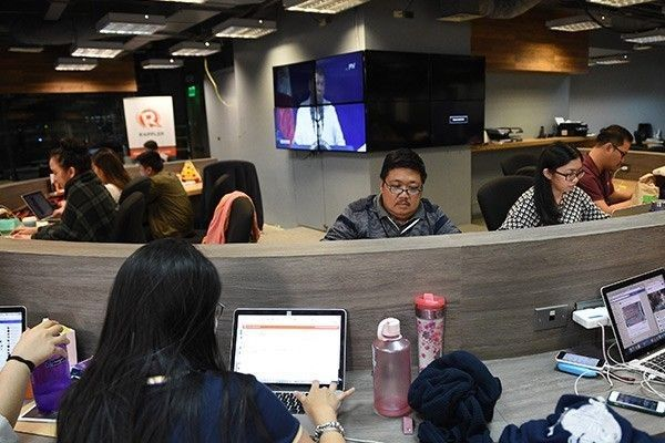 This file photo taken on Jan. 15, 2018 shows employees of online portal Rappler working at the company's editorial office in Manila. President Rodrigo Duterte's move to ban news website Rappler from covering the presidential palace is a threat to press freedom, rights and media groups said on February 21, 2018.