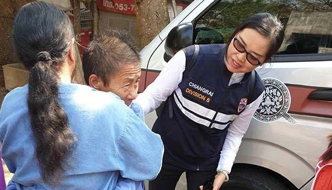 In this handout photo taken and released by the Thai Immigration Police on February 15, 2019 Kaeomanee Arjaw, (2nd L), embraces a relative upon arriving home in Chiang Rai as a Thai Immigration Police looks on. A 59-year-old Thai woman with dementia who left home eight months ago to see her son nearby, only to apparently walk 640 kilometres (400 miles) into China, arrived back in the kingdom on February 15. Arjaw, who is from the ethnic Akha hill-tribe, was reported missing on June 12 from her house in the Thai province of Chiang Rai, part of the mountainous 'Golden Triangle' zone which borders Laos and Myanmar.