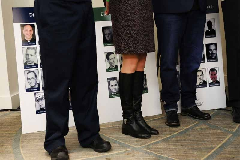 Survivors of sexual abuse by priests and clergy stand before photos of accused religious men during a news conference with lawyer Jeff Anderson of Jeff Anderson & Associates on February 14, 2019 in New York City. Anderson, who has specialized in representing survivors of clergy abuse, announced the filing of a lawsuit naming the Catholic Conference of Major Superiors of Men for concealing from the public, parishioners, and law enforcement, the histories and identities of religious order of priests and brothers accused of sexually abusing children.