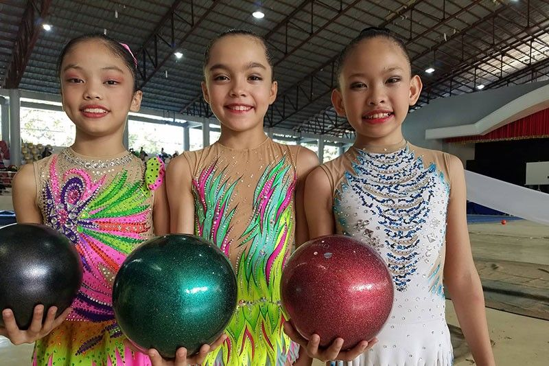 Team Cebu City's Ziah Tajanlangit, Leanne Marie Manning and Leann Mae Lubang pose after a dominating performance in the gymnastics event of 2019 Central Visayas Regional Athletic Association(CVIRAA)  Meet yesterday in Dumaguete City.