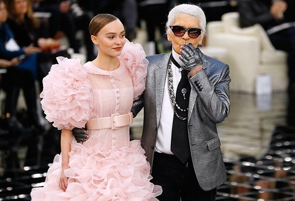 In this file photo taken on January 24, 2017 German fashion designer Karl Lagerfeld (R) acknowledges the audience next to French-US actress and model Lily-Rose Melody Depp at the end of the Chanel during the 2017 spring/summer Haute Couture collection at the Grand Palais in Paris. German fashion designer Karl Lagerfeld has died at the age of 85, it was announced on February 19, 2019.