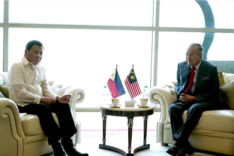 Malaysia�s Mahathir tells Philippines: �Be very careful� with Chinese loans