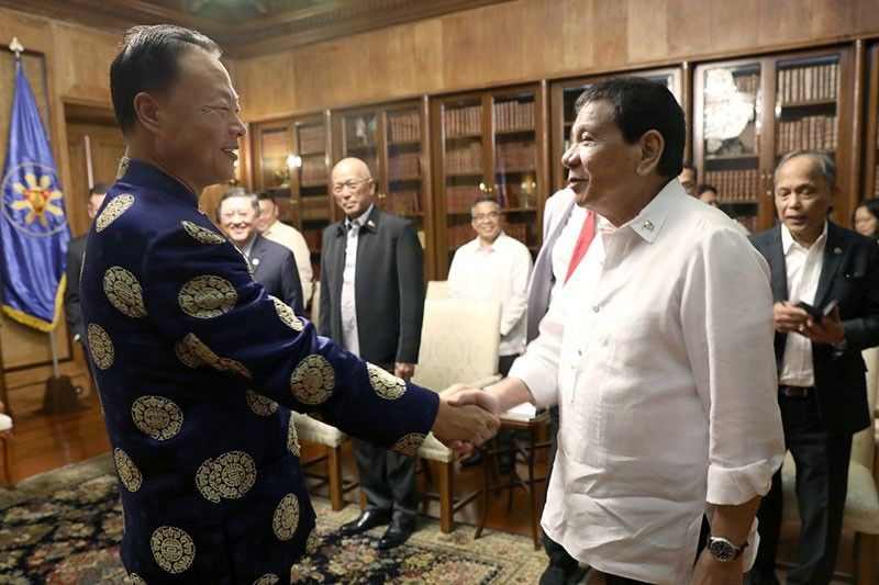 In this Oct. 8, 2018 photo, President Rodrigo Duterte greets Chinese Ambassador Zhao Jianhua who paid a courtesy call on the president at the Malacañan Palace.