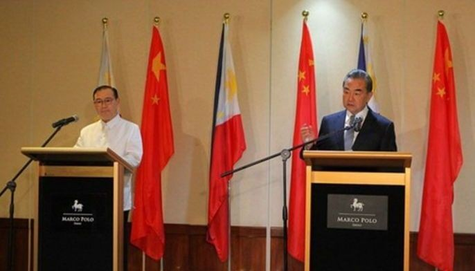 In this Oct. 29, 2018 photo, Chinese State Councilor and Foreign Minister Wang Yi and Foreign Affairs Secretary Teodoro Locsin Jr. jointly meets the press after their talks in Davao. Upon the invitation of Wang, Locsin will undertake an official visit to China from March 18 to 21.