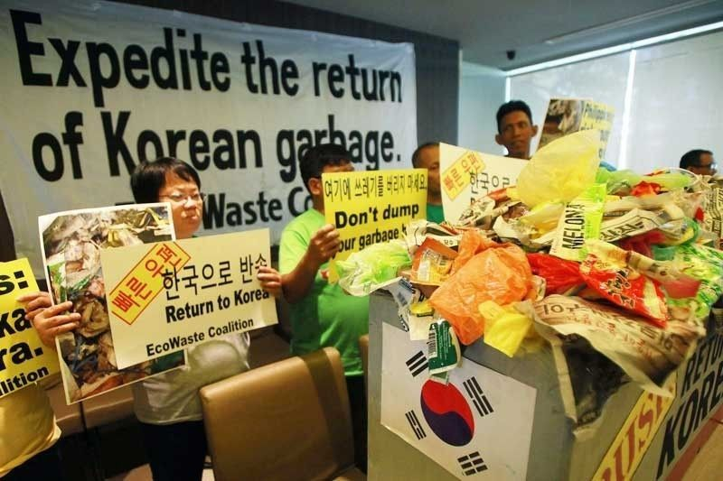 This file photo shows members of the EcoWaste Coalition protesting the tons of garbage shipped from South Korea.
