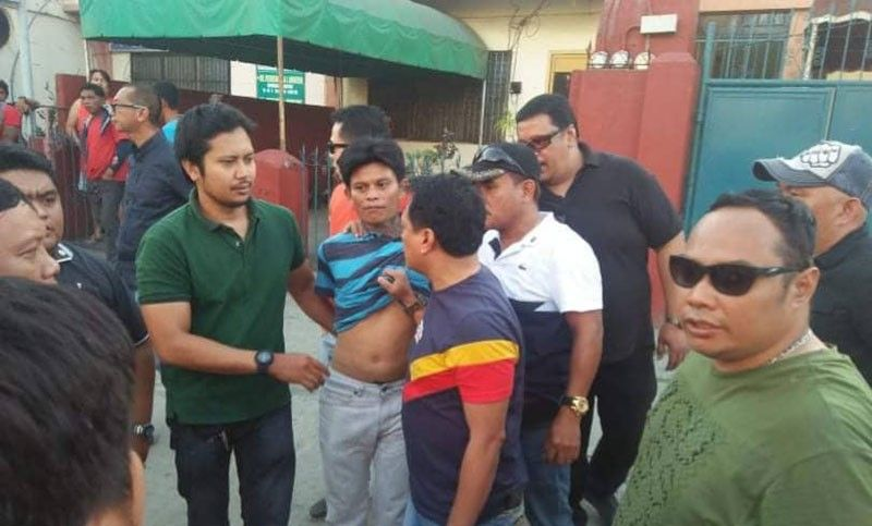 Joint operatives of the National Bureau of Investigation and Police Regional Office-11 arrest Jonas Bueno in Davao City yesterday afternoon.