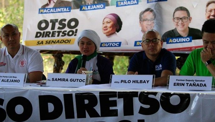 "In this March 20 photo, ""Otso Diretso"" senatorial bets Gary Alejano, Samira Gutoc, Florin Hilbay and Erin Tañada talk at a campaign sortie in Navotas City."