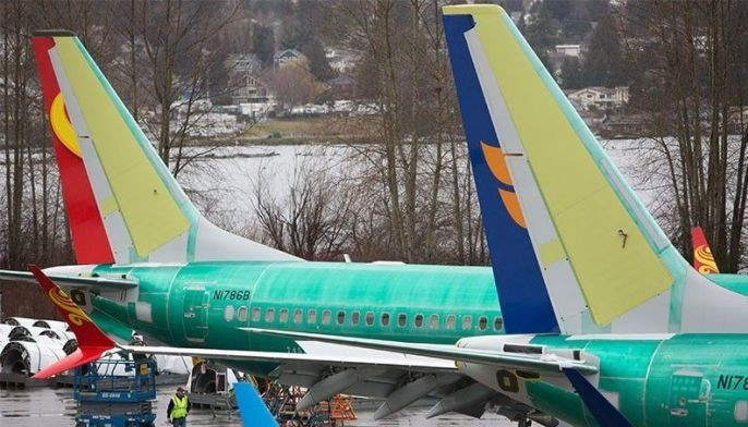 (FILES) In this file photo taken on March 12, 2019 Boeing 737 MAX airplanes are pictured at the Boeing Renton Factory in Renton, Washington. Boeing's 737 MAX aircraft will be outfitted with a warning light for malfunctions in its MCAS anti-stall system, suspected in October's fatal crash in Indonesia, an industry source told AFP. This safety light, which had been optional, will become standard and is among the modifications the company will present to US authorities and clients in the coming days, the source said on condition of anonymity.