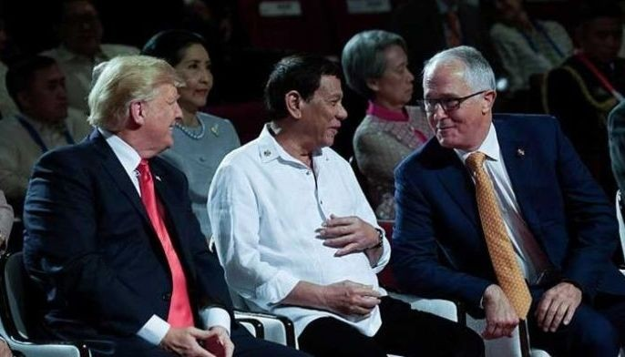 President Rodrigo Duterte shares a light moment with US President Donald Trump and Australia Prime Minister Malcolm Turnbull on the sidelines of the 31st Association of Southeast Asian Nations Summit and Related Summits at the Cultural Center of the Philippines opening ceremony in Pasay City on Nov. 13, 2017.