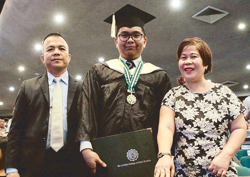 Janrey, a security guard�s son, graduates summa cum laude