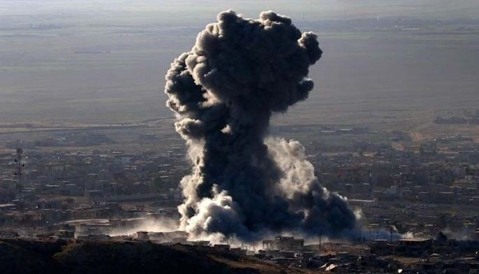 """In this file photo, Heavy smoke billows during an operation by Iraqi Kurdish forces backed by US-led strikes in the northern Iraqi town of Sinjar on November 12, 2015, to retake the town from the Islamic State group and cut a key supply line to Syria. Kurdish-led forces announced on March 23, 2019 they had fully captured the Islamic State group's last bastion in eastern Syria and declared the total elimination of the jihadists' """"caliphate""""."""