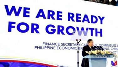 Finance Secretary Carlos Dominguez speaks before more than 500 Chinese investors and delegates who attended the Philippine Economic Briefing held recently in Beijing.