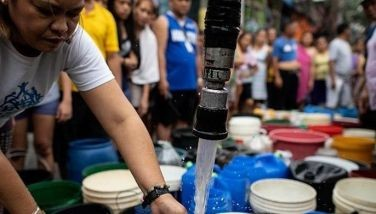 Residents of Addition Hills in Madaluyong City, Metro Manila, queue to recieve water distributed on water tank truck and fire trucks on March 15, 2019.