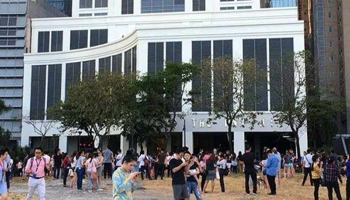 Tenants of buildings at Bonifacio Global City in Taguig City evacuate after a strong earthquake was felt Monday afternoon.