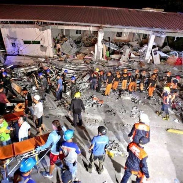 Rescue teams search for survivors at the collapsed Chuzon supermarket in Porac, Pampanga following a magnitude 6.1 earthquake that rocked Luzon yesterday. About 100 people were feared  to have been buried in the supermarket.