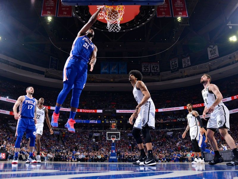 Embiid stars as 76ers rip Nets to move on