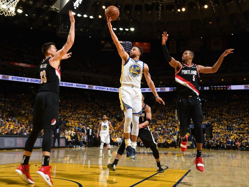 a04f9d04bf5a Stephen Curry of the Golden State Warriors goes to the basket against the  Portland Trail Blazers during Game One of the 2019 Western Conference  Finals of ...