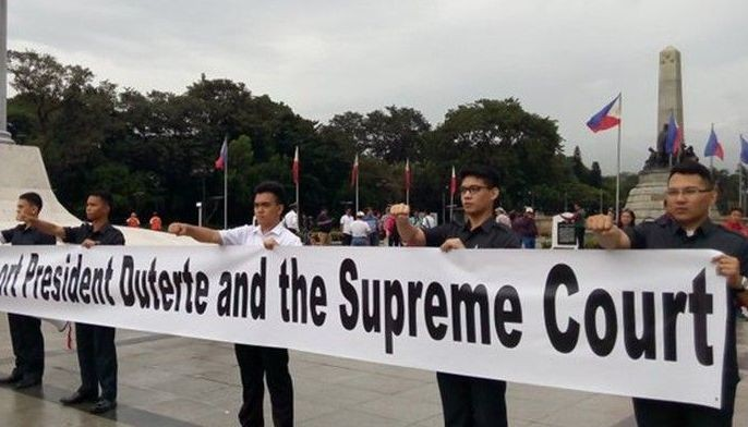 SEVEN STRONG: Cardema (R) and six other members of the Duterte Youth hold up a banner during a Black Friday protest against the burial of the remains of ousted dictator Ferdinand Marcos at the Libingan ng mga Bayani in November 2017