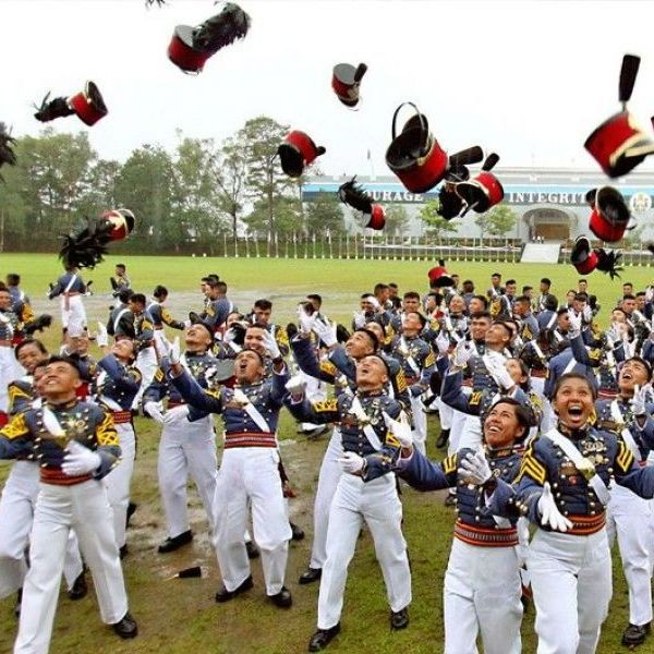 Drenched in a downpour, members of the Philippine Military Academy�s �Mabalasik� class throw their �shakus� up in the air after graduating yesterday.