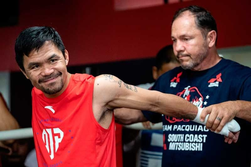Arum warns Pacquiao of huge risk