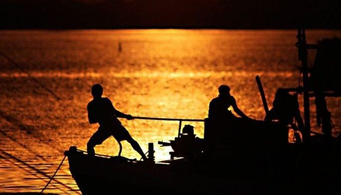 Fishermen at the San Jose fish port in Occidental Mindoro, which faces the West Philippine Sea, prepare to set sail before dawn on June 15.