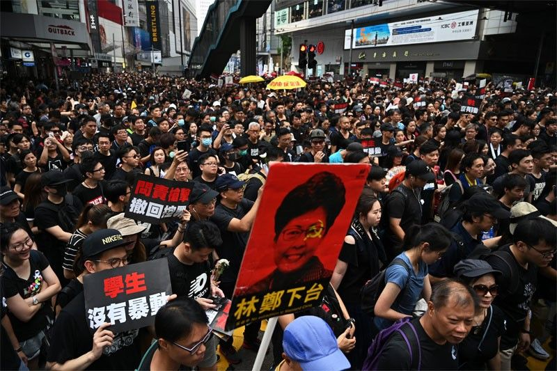 Hong Kong leader offers 'most sincere apology' over law turmoil