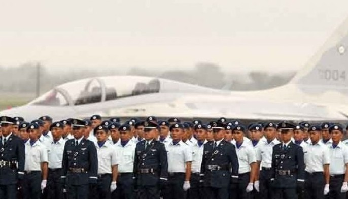 This file photo shows officer and airmen of the Philippine Air Force. President Duterte said the Air Force would take over the Ninoy Aquino International Airport if security there is not improved.