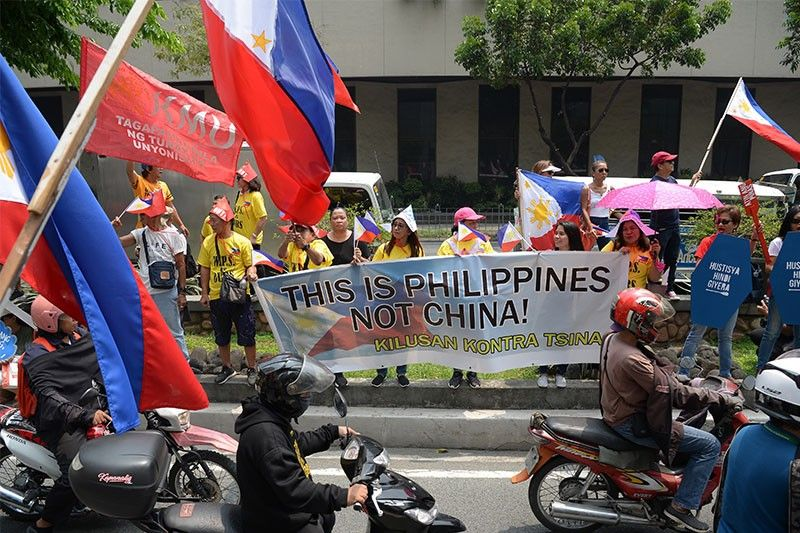 Raising war with China over arbitral award meant to 'scare' Filipinos